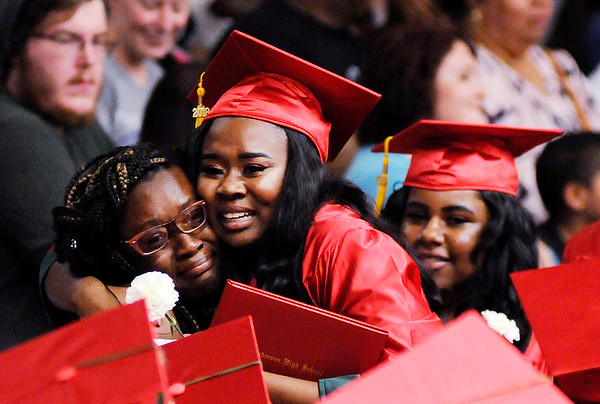Don Knight | The Herald Bulletin<br /> A student gets a big hug as she walks back to her seat during Anderson's graduation on Tuesday.