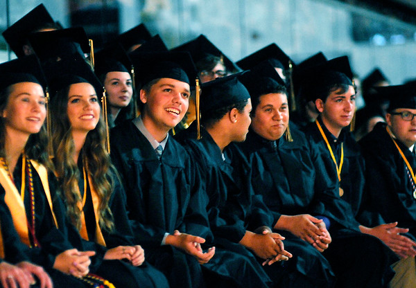 Don Knight | The Herald Bulletin<br /> Daleville graduates watch a slide show of photos of their classmates as the Broncos held their commencement on Friday.
