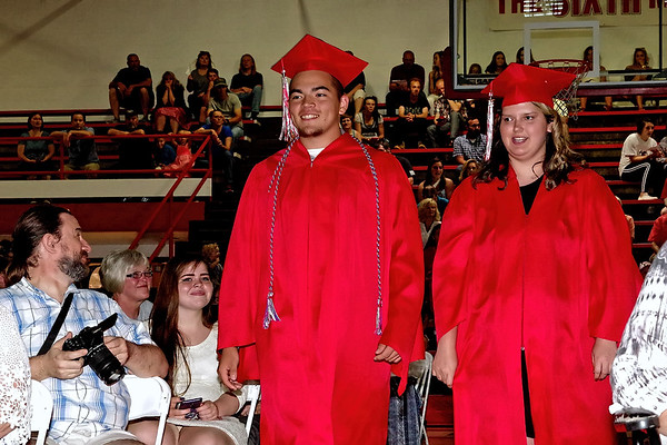 Surrounded by family and friends, members of the Frankton High School Class of 2018 process into the gymnasium for commencement on Friday evening.