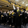 Don Knight | The Herald Bulletin<br /> Lapel graduates toss their mortar board's in the air at the conclusion of their commencement ceremony on Saturday.