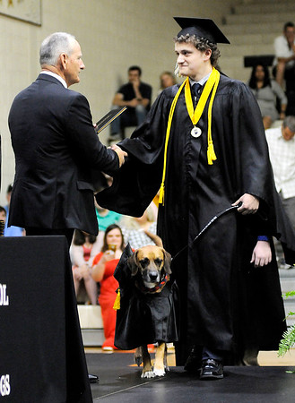 Don Knight | The Herald Bulletin<br /> Hunter Brinson receives his diploma from Superintendent Bobby Fields as he walks across stage with his service dog Mr. Darcy as Lapel held their graduation on Saturday.