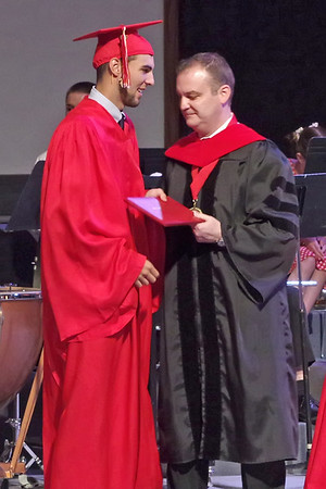 Liberty Christian senior Dallas Burko receives his diploma from Dr. Jay McCurry during commencement ceremonies at Eastside Church of God on Saturday.