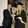Mark Maynard | for The Herald Bulletin<br /> Dr. Scott Deetz, Superintendent of Madison-Grant Schools, presents Alexis Burton with her diploma at graduation ceremonies.