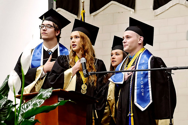 Mark Maynard   for The Herald Bulletin<br /> Graduating Madison-Grant Seniors Christian Wampner, Haylie Marshall, Danyelle Hutson and Christian Kent, all of whom have enlisted in the Armed Forces, lead the Pledge of Allegiance during commencement exercises.