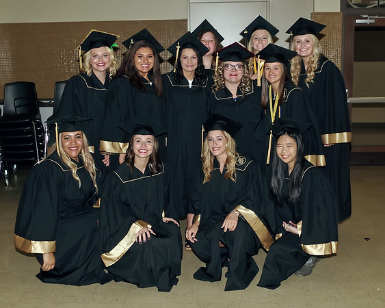 Mark Maynard | for The Herald Bulletin<br /> A group of graduating Madison-Grant Senior ladies pose for a picture prior to commencement exercises.
