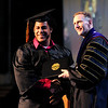 Don Knight | The Herald Bulletin<br /> Dayan Rene Smith receives his diploma from Anderson University President John Pistole during AU's Commencement on Saturday.