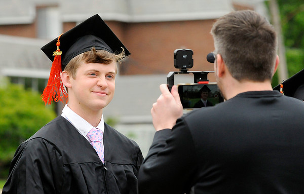 Don Knight   The Herald Bulletin<br /> Anderson University basketball coach Owen Handy interviews one of his graduating players Wes Davidson as AU held their 101st Commencement on Saturday.