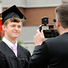 Don Knight | The Herald Bulletin<br /> Anderson University basketball coach Owen Handy interviews one of his graduating players Wes Davidson as AU held their 101st Commencement on Saturday.