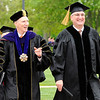 Don Knight | The Herald Bulletin<br /> Anderson University President John Pistole and Governor Eric Holcomb lead the procession to the Kardatzke Wellness Center for AU's Commencement on Saturday.