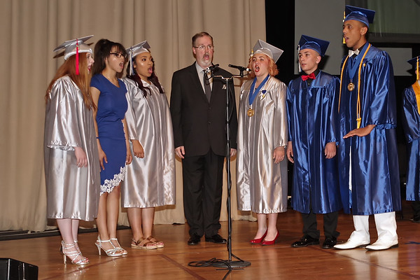"""The APA choral group """"Vocal Point"""" perform the Nation Anthem at the start of Graduation Ceremonies.  (Mark Maynard photo)"""