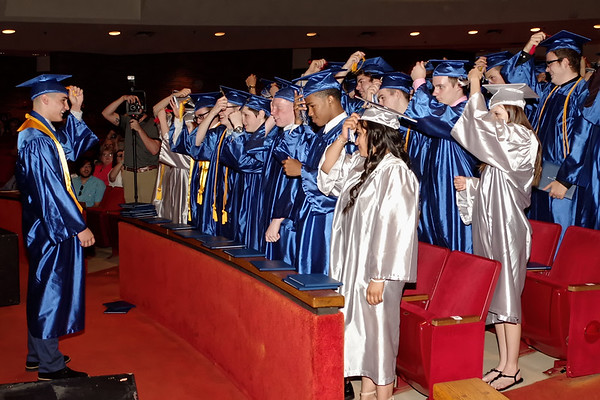 Class President Preston McNeal leads his classmates in the turning of thier tassels indicating they are offically graduates of Anderson Preparatory Academy.  (Mark Maynard photo)