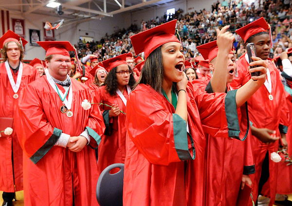 Don Knight | The Herald Bulletin<br /> Students react after turning their tassel during Anderson High School's Commencement on Tuesday.
