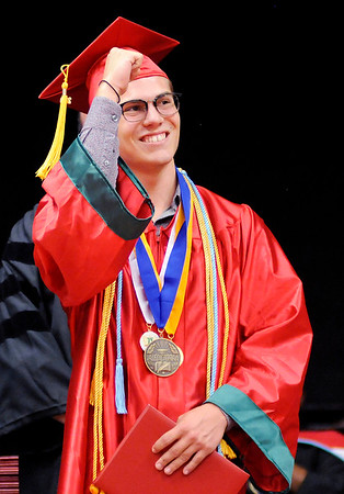 Don Knight | The Herald Bulletin<br /> William Landen Wood looks to the crowd after receiving his Valedictorian metal during Anderson High School's Commencement on Tuesday.
