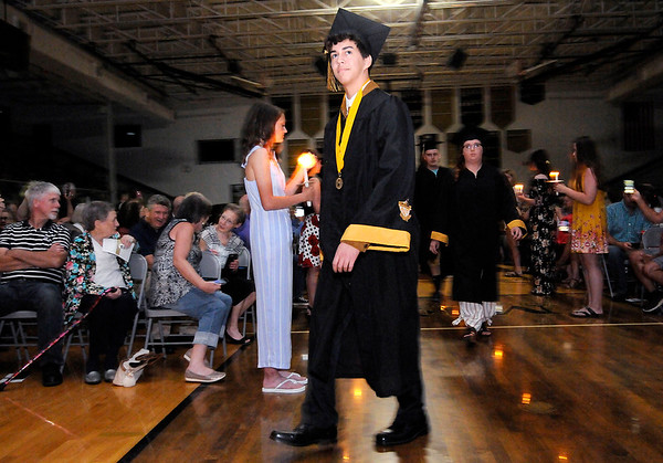 Don Knight | The Herald Bulletin<br /> Graduates file into the gym during the processional as Daleville held their Commencement for the Class of 2019 on Friday.