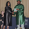 Denise Fuller presents Daryus Grier with his diploma from the Excel Center on Friday evening.  (Mark Maynard photo)
