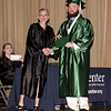 Excel Center Class of 2019 graduate Lee Shepheard accepts his diploma from Carolyn McKinney.  (Mark Maynard photo)