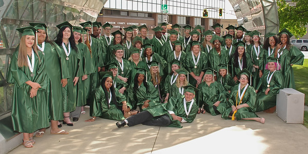 The Excel Center Graduating Class of 2019 poses for a group photo under the Crystal Arch prior to commencement in the Anderson City Building Auditorium on Friday evening. (Mark Maynard photo)