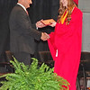 School Superintendent Bobby Fields presents Megan Isaacs with her diploma during Frankton High School's Commencement on Sunday. (Mark Maynard photo)