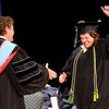 Don Knight | The Herald Bulletin<br /> Cindy Johnson gives a celebratory fist pump as she walks across the stage to pick up her degree during Ivy Tech's commencement on Tuesday.