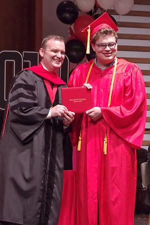 Dr. Jay McCurry presents Liberty Chirstian graduating Senior Elliott Lamb with his diploma.  (Mark Maynard photo)