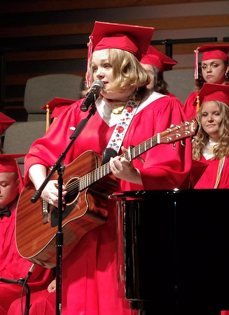 "Senior Cassidy sings ""Love You Always,"" which she composed, to open Liberty Christian School's Commencement ceremonies. (Mark Maynard photo)"