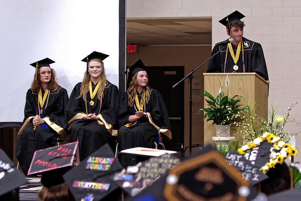 As his Co-Valedictorians Mia Stewart, Haley Scott and Brenna Miller look on, Hayden Rutherford delivers his portion of the Valdictory Address during Madison-Grant's Commencement. (Mark Maynard photo)