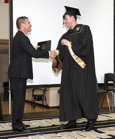 Madison-Grant Senior Blaze Ethan Campbell receives his diploma. (Mark Maynard photo)