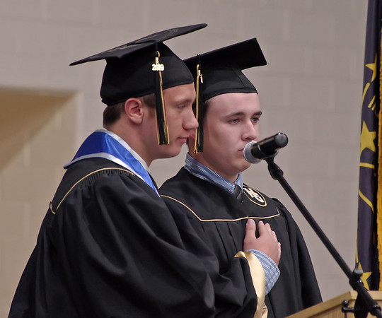 Madison-Grant graduating Seniors Steven Frye and Ryan Martin lead, who have already joined the United States military, lead the Pledge of Allegiance. (Mark Maynard photo)