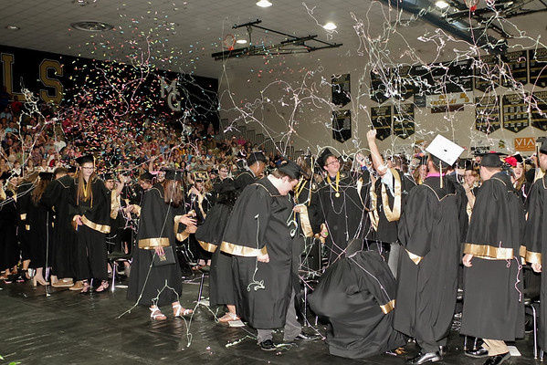 The Madison-Grant Class of 2019 celebrate their graduation with confetti and silly string. (Mark Maynard photo)