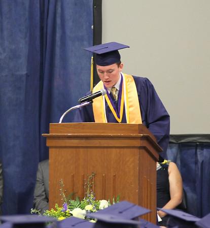Photo by Chris Martin for The Herald Bulletin. Salutatorian Cory Evans speaks to classmates during the Shenandoah graduation held Sunday.