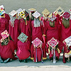 Alexandria High School graduating Seniors show off their decorated mortor boards prior to Commencement on Friday.