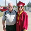 Alexandria High School Band Director Gary Wallyn poses for a photo with graduating band member Kami Horn prior to commencement.