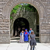 A newly-graduated Elwood High Senior and his parents pose for a traditional photo below the school's lime-stone entry arch.  (Mark Maynard photo)