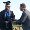 Cody Buster receives his Technical Honors Diploma from Superintendent Scott Deetz during Madison-Grant's graduation on Friday.