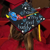 Madison Schuyler shows off her decorated mortorboard during Alexandria Monroe High School's Commencement exercises on Friday evening.