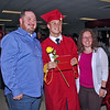 Dustin, Brayden and Stephanie Jacobs pose for a photo after Alexandria's Commencement Ceremonies on Friday evening.