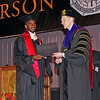 Makesi Kyle Lewis receives his Master of Business Administration diploma from Anderson University President John S. Pistole on Saturday.