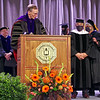 Anderson University President John S. Pistole addresses Charles R. Carroll upon his receipt of the Honorary Degree of Doctor of Humane Letters.