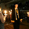 Daleville Junior-Senior High School Class of 2021 Graduates marched into their commencement ceremony by candle light Friday evening.