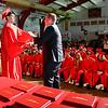 Liberty Christian High School senior Joshua Cabello receives his diploma from school principal Adam Freeman Saturday during commencement excercises.