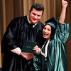 Don Knight | The Herald Bulletin<br /> Michelle Infante celebrates as she receives her degree from Elvis Jones during The Excel Center graduation at the City Building on Thursday. The event honored 39 graduates who overcame barriers to receive a Core 40 high school diploma.