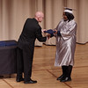 APA graduating senior Savannah Averitte receives her diploma from Director Steve White.