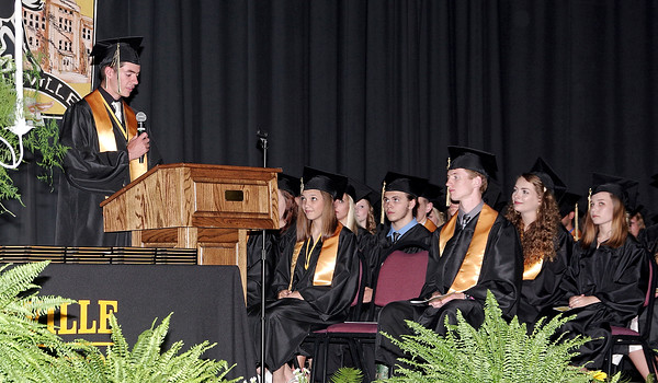 Mark Maynard | For The Herald Bulletin<br /> Valedictorian Brandon Vermillion addresses his Dalville High School classmates during graduation ceremonies Friday evening in the school gymnasium.