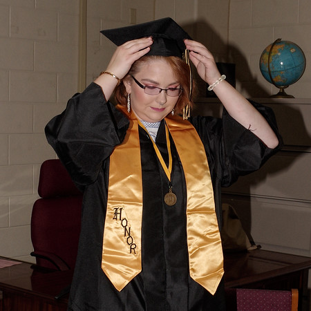 Mark Maynard | For The Herald Bulletin<br /> Melissa Scott adjusts her mortarboard in preparation for Daleville High School's graduation ceremony.