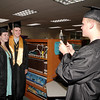 Mark Maynard | For The Herald Bulletin<br /> Graduating Davile HIgh School Senior Jacob West snaps a photo of classmates Loren Rossner and Nick Dodge prior to commencement exercises on Friday evening.