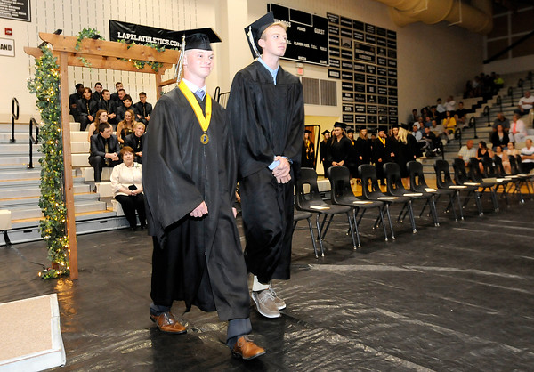Don Knight | The Herald Bulletin<br /> From left, Austin Begley and Triston Carpenter file into the gym during the processional at Lapel's graduation on Saturday.