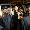 Don Knight | The Herald Bulletin<br /> Senior members of Lapel's band present retiring band director Greg Scott a gift bag and flowers before giving him a group hug during graduation on Saturday. Scott has been the band director at Lapel for 37 years.