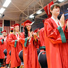 Don Knight | The Herald Bulletin<br /> Students give an ovation to family, friends and teachers that helped them graduate during Anderson High School's commencement on Sunday.