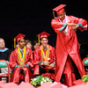 Don Knight | The Herald Bulletin<br /> Dashaun Johnson Jr. dabs as he crosses the stage to receive his diploma during Anderson High School's graduation on Sunday.