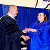 Mark Maynard | for The Herald Bulletin<br /> Elwood School Superintendent Christopher Daughtry gives Sarah Arthur her diploma and a congratulatory hand-shake during graduation ceremonies held on Sunday afternoon.